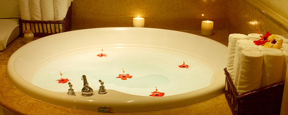 Relax in a lovely hot tub for your romantic evening to begin